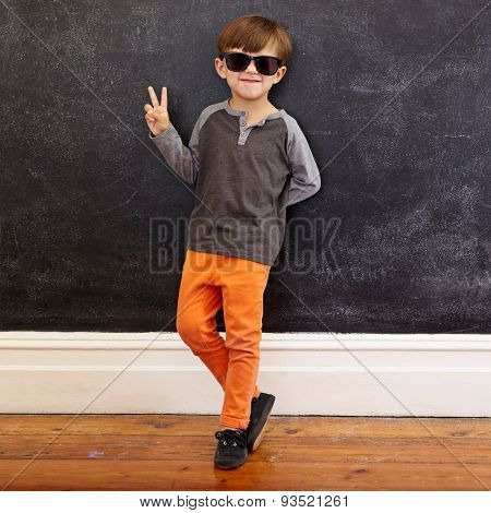 Cool Little Boy Gesturing Victory Sign