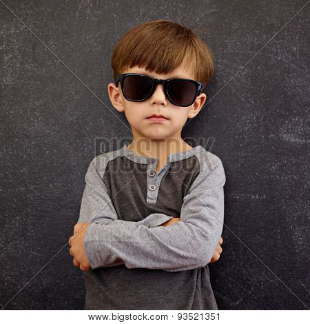 Little Boy Wearing Sunglasses Posing With His Arms Crossed