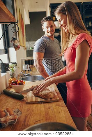 Caucasian Couple In The Kitchen Preparing Breakfast