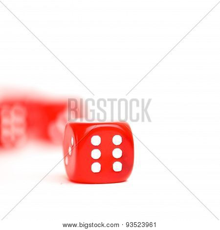 rolling red dice isolated on white