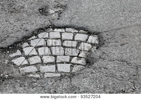 Pothole With Old Gray Stone Pavement