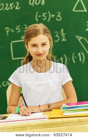 Back to school - young schoolgirl in the classroom