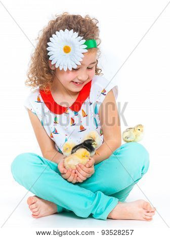 Girl holding baby chickens