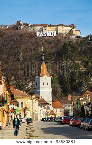 Medieval fortress and the sign with the town name in Rasnov, Romania