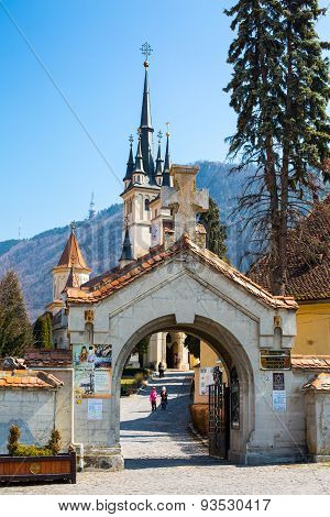 Entrance gate and Saint Nicholas Church in Brasov, Transilvania