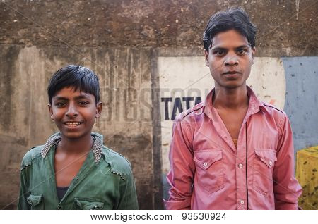 MUMBAI, INDIA - 12 JANUARY 2015: Young Indian men in Dharavi slum