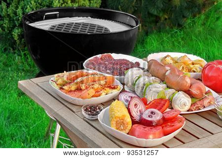 Close-up View On Wood Picnic Table  With Different Cookout Food
