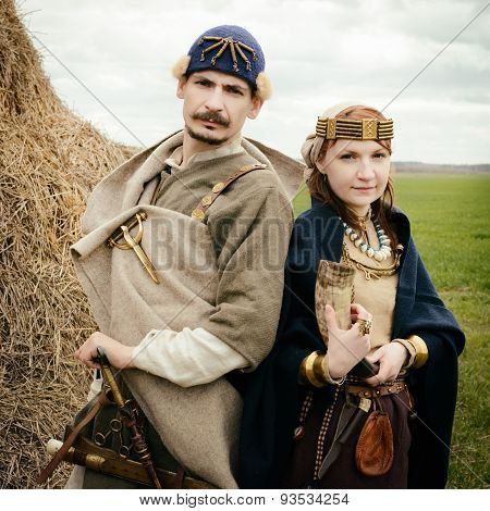 Woman And Man In Ethnic Suit  Context Historical Reconstruction