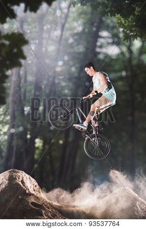 bmx bike rider in the forest