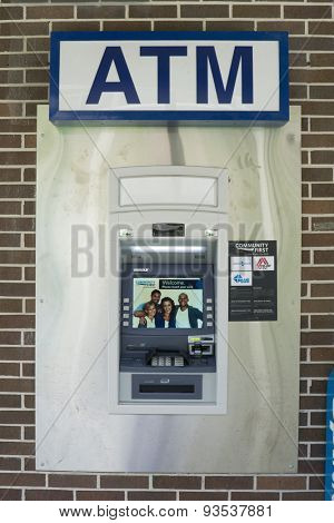 JACKSONVILLE, FL. USA - JUNE 13, 2015: An ATM machine in Jacksonville. The first modern ATM was an IBM 2984 and came into use at Lloyds Bank, Brentwood High Street, Essex, England in December 1972.