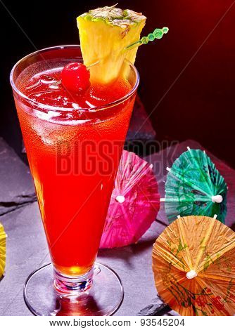 Pineapple cocktail with cherry and umbrella  in highball glass . Cocktail card 68