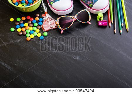 kid's stuff and sweets on a white background