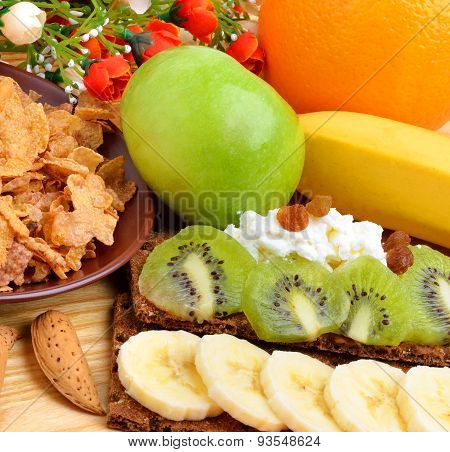 Healthy Food. Fresh Fruit And Dry Loaves With Curd On A Wooden Background