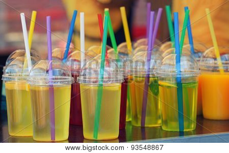 vivid drink in plastic glasses