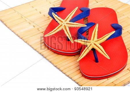 Red Flip-flops, Slippers With Starfish On The Wooden Background Isolated On White