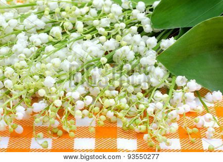 Lilies Of The Valley On The Orange Tablecloth