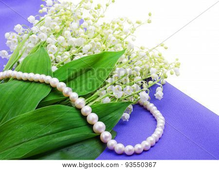 Lilies Of The Valley An Pearl Necklace On Blue Isolated