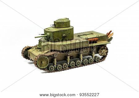 Paper model of an old battle tank isolated on white background.