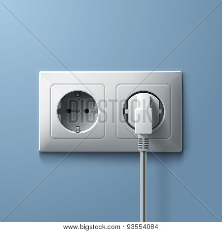 Electric white plug and socket on blue wall background