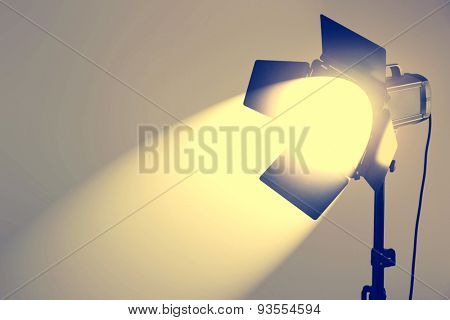 Photo studio with lighting equipment on wall background