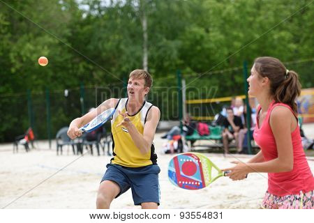 MOSCOW, RUSSIA - MAY 31, 2015: Yulia Chubarova and Nikolay Guriev in the match of Russian beach tennis championship. 120 adults and 28 young athletes compete in the tournament