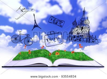 Open book with drawings on sky background