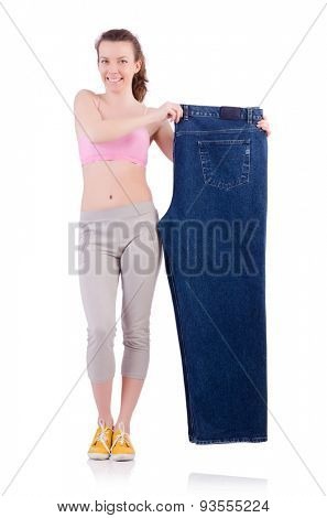 Woman with oversized jeans in dieting concept