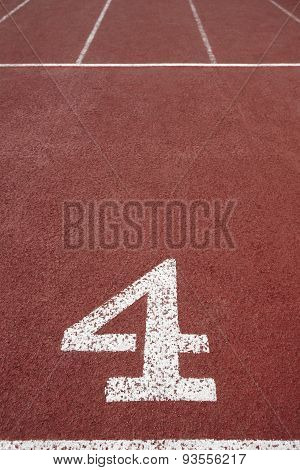 Number Four Signpost In An Athletic Running Track