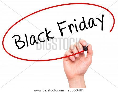 Man Hand writing Black Friday with black marker on visual screen.