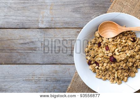 Cornflakes On Wooden Table At Morning