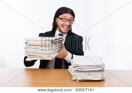 Businessman overwhelmed and stressed from paperwork