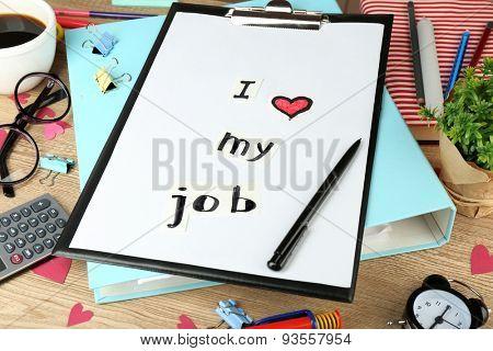 Inscription I love my job on workplace