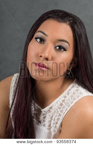 Solemn Young Woman With Beautiful Eyes And Lips