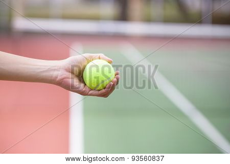 Tennis Player Holding The Ball And Getting Ready To Serve
