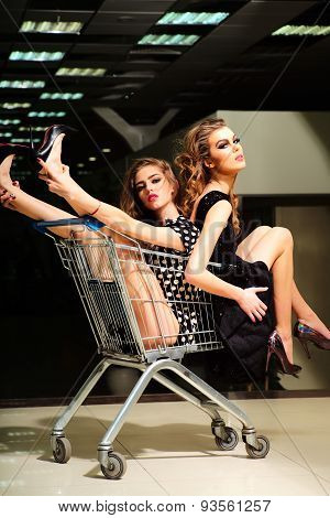 Enigmatic Girls With Shopping Trolley