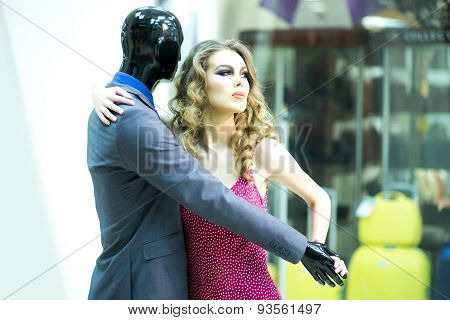 Secretive Girl And Mannequin