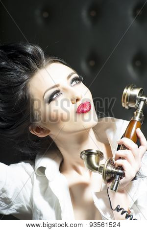 Alluring Woman And Golden Telephone