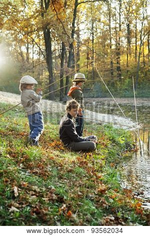 happy boys go fishing on the river, photo with artistic lens flare