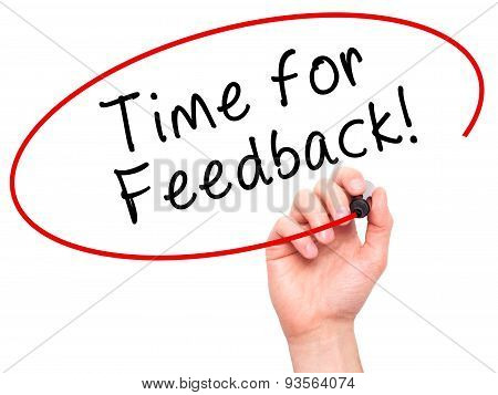 Man Hand writing Time for Feedback with black marker on visual screen.
