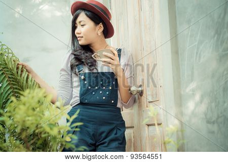 Asian Beautiful Cute Girl In The Cafe Garden With Coffee Smiling