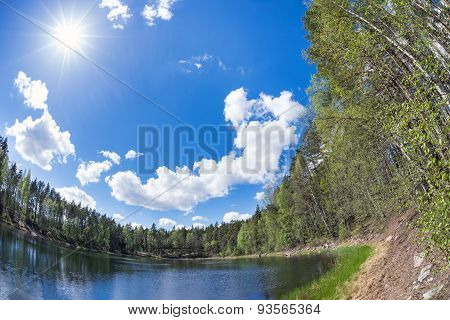 Lake In The Forest With Blue Sunny Sky