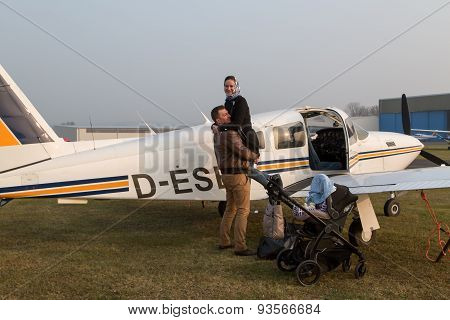 Wife Hugging Her Husband After The Flight.
