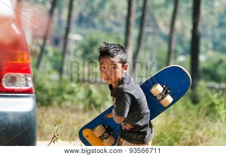 Indian Boy With Skateboard On The Street In Bangalore