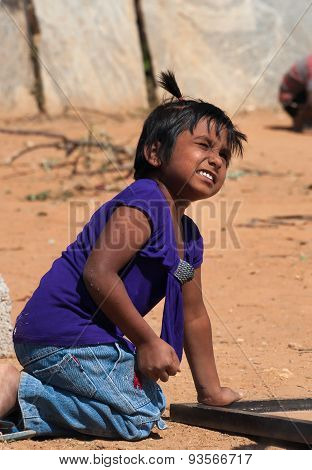 Indian Girl Playing On The Street In Bangalore