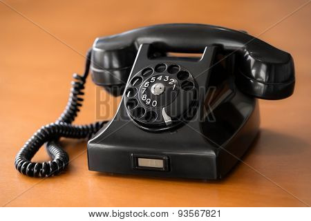 Old Rotary Dial Phone On Wooden Table