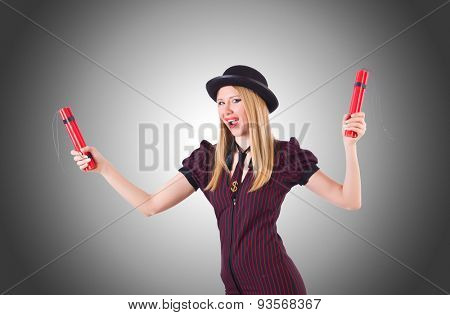 Woman gangster with dynamite sticks against the gradient