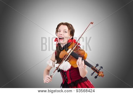 Woman with violin against the gradient