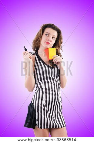 Woman referee with card against the gradient