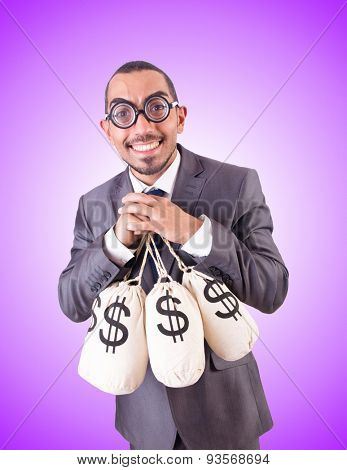 Man with sacks of money against the gradient