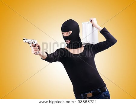 Criminal with gun against the gradient